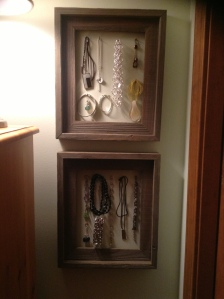 Jewelry hung inside an empty Frames