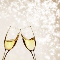 Glasses with champagne against fireworks and clock close to midn